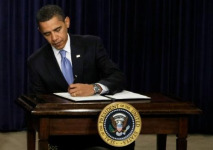 President Obama Signs bill Alone
